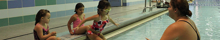 Child jumping in the pool for a lesson